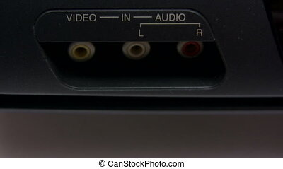 Composite AV Cable - Inserting various audio and video...