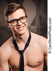 Shirtless business Handsome young man in eyewear and necktie...