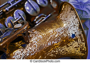Old saxophone - Close up of a old tenor saxophone.