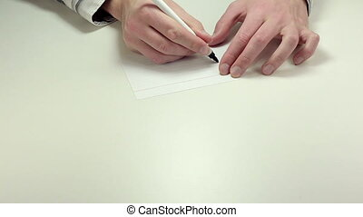 Written note Right - Man hands write the word Right on white...