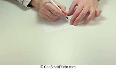 Written note Order - Man hands write the word Order on white...