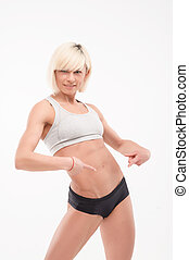 part of the athletic female body - athletic girl shows taut...