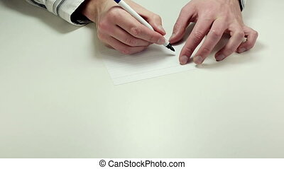 Written note Urgent - Man hands write the word Urgent on...