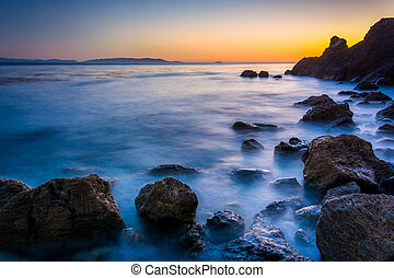 Long exposure of waves crashing on rocks at Pelican Cove at...