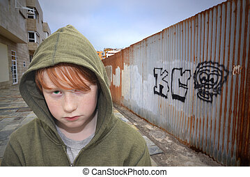 young hooligan - sad redhead boy standing on a lonely street
