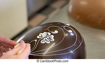 hands pastry chocolate easter eggs