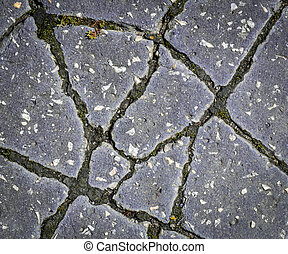 chapped asphalt pavement - background or texture chapped...
