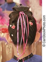 Brunette little girl with hairdo