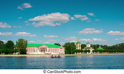 Kuskovo palace and pond with boats in the sunny summer...