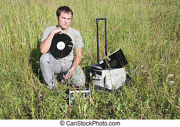man with  vinyl disk and radio