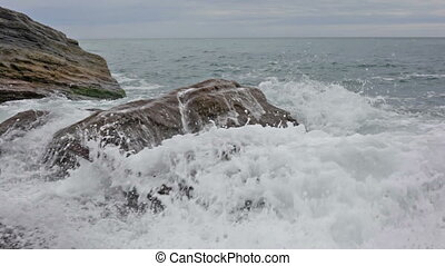 Sea waves break about the coast, Laguria, Italy