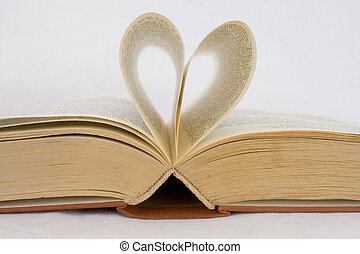 opened book - Pages of a book curved into heart shapes