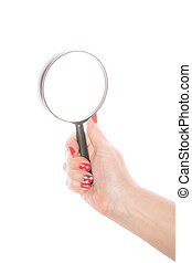 Female hand holding magnifying glass on a white background -...