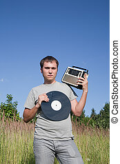 man with  vinyl disk and radio receiver