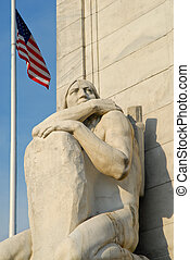 Native American - Statue of Native American crouching at...