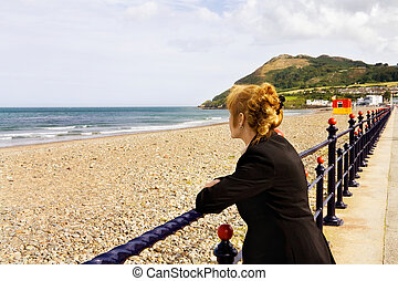 Woman looking at the sea - Woman with red hair looking at...