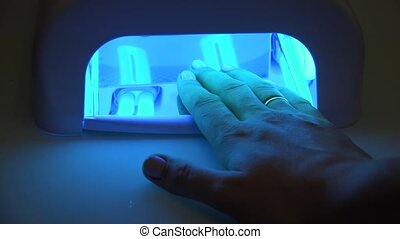 Hand in UV Lamp Nail Dryer. - Hand in UV Lamp Nail Dryer....