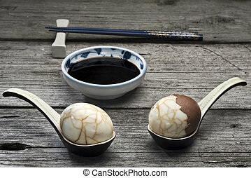 Chinese tea eggs with soy sauce - Two traditional Chinese...