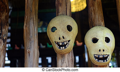 Wooden mask on the wood wall