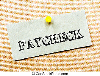 Recycled paper note pinned on cork board. Paycheck Message....