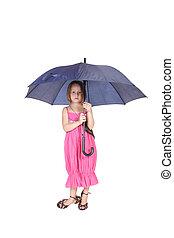 Pretty little girl standing holding a blue umbrella