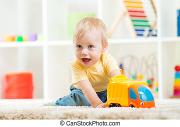 child boy toddler playing with toy car