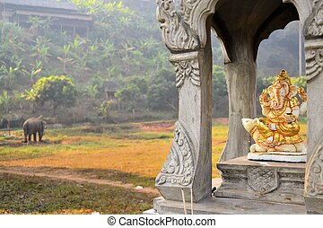 Ganesha shrine with elephant in background - Sitting Ganesha...