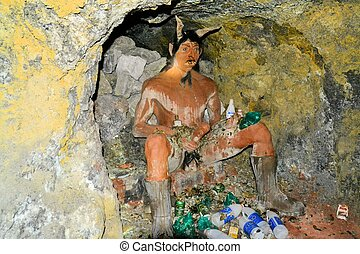 El Tio in the mines of Cerro Rico, Potosi, Bolivia - One of...