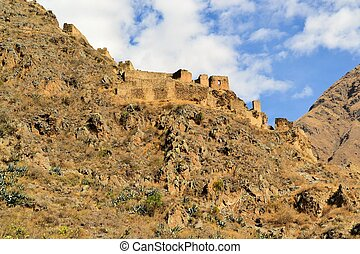 Inca fortress in Sacred Valley, Ollantaytambo, Peru -...