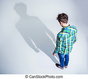 Top view portrait of a young man in colourful wear standing...