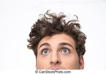 Crop image of a handsome young man with curly hair looking...