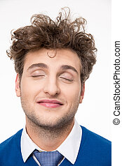 Happy young man with closed eyes