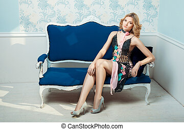 Girl in dress on the couch.