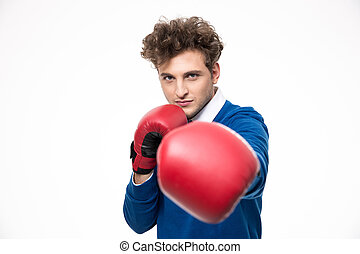 Business man in boxing gloves punching at the camera