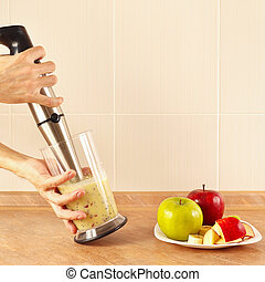 Hands chefs mixed fruit smoothie in blender - Hands chefs...