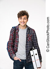 Happy young man standing with backpack and folders