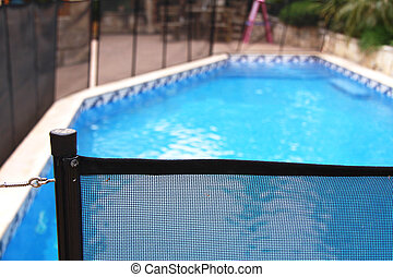 swimming pool safety net - a net around a swimming pool for...