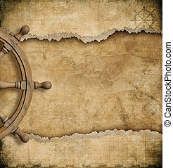 steering wheel and torn vintage nautical map - steering...