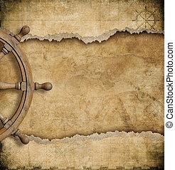 steering wheel and torn vintage nautical map - steering...