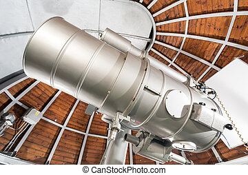 Modern astronomy telescope in an astronomical observatory. -...