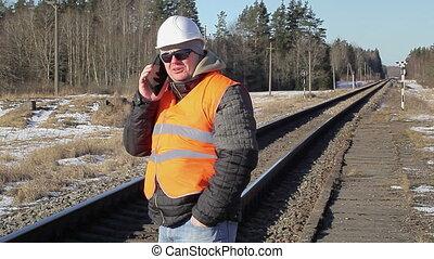 Railway employee talking on the cel