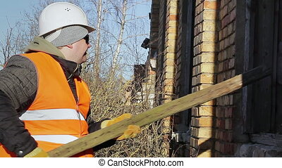 Construction worker with a wooden
