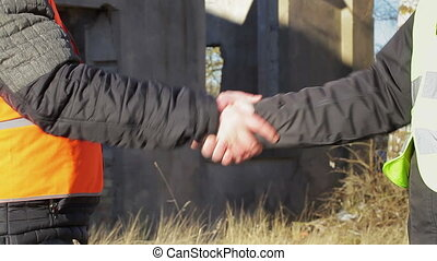 Two engineer's hands grip in greeted