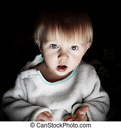 Surprised Baby Boy Portrait in the Dark Room