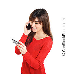 Girl with credit card on mobile phone
