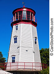 Prescott Lighthouse against blue sky. Ontario, Canada.