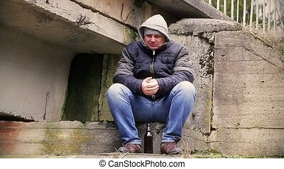 Man in cold weather under the bridge