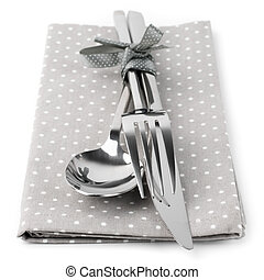 Cutlery set: spoon, fork and knife on gray napkin isolated...