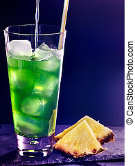 Green pineapple cocktail on dark background 4 - Green...