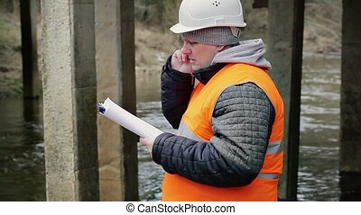 Engineer talking on the cell phone